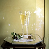 A Glass of Champagne; Cork and Bunch of Grapes