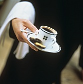 Waiter Carrying Cup of Coffee with Cookies