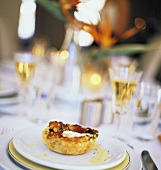 Table Setting with Spinach and Puff Pastry Appetizer