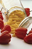 Red Bell Peppers with a Jar of Penne Pasta