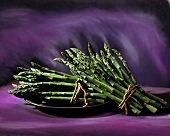 Bunches of Green Asparagus; Purple Background
