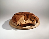 Round Loaf of Raisin Bread, Partly Sliced