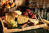 Cheese Assortment on Wicker Tray with Bread and Fruit