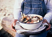 Woman Holding Shellfish Stew
