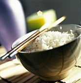 A Bowl of White Rice with Chopsticks