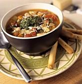 Minestrone al pesto (Vegetable soup with pesto & grissini)