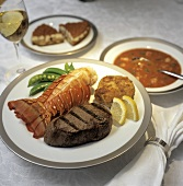 Surf and Turf: Lobster Tail with Steak and a Crab Cake