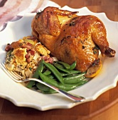 Half roast chicken with stuffing and peas