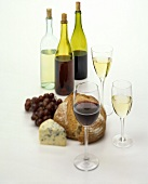 Still life with wine, bread, cheese and grapes