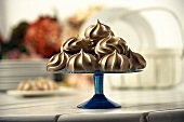 Chocolate Meringues on a Blue Glass Stem Plate