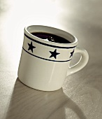 Black Coffee in a Mug with Stars