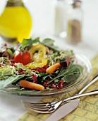 Salad leaves with vegetables; olive oil