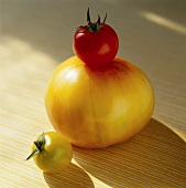 Two Yellow and One Red Tomato