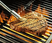 Steak on Flaming Barbeque