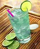 Blue Margarita in a Tall Glass with a Straw and Lime Garnish