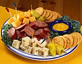 An Hors d'oeuvre Platter with a Selection of Meats, Cheeses and Crackers
