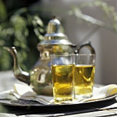 A Pot and Two Glasses of Mint Tea