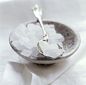 Sugar Crystals in a Clay Bowl and on a Spoon
