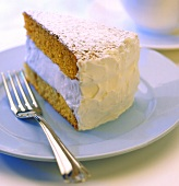 A SLice of Spice Cake with White Cream Frosting