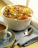 A Bowl of Cereal with Fresh Peaches