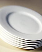A Stack of White Plates