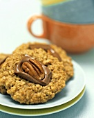 An Oatmeal Cookie Topped with Chocolate and a Walnut