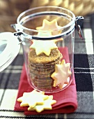 Star Sugar Cookies and Gingerbread Cookies in a Glass Cookie Jar