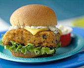 A Fish Fillet Sandwich with Tartar Sauce and Cheese