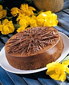 A chocolate cake with floral deocration
