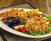 Barbecued shrimps with chips and corncob