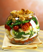 Vegetable salad with cheese, egg & croutons, layered in glass