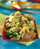 Farfalle with mushrooms, spinach and spring onions