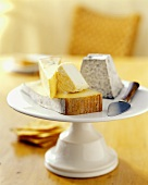 Assorted Cheese on a White Pedestal