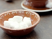 Sugar Cubes in a Brown Bowl