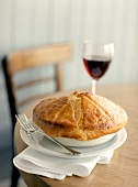A Pot Pie with a Glass of Red Wine