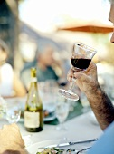 A Man About to Sip from a Glass of Red Wine