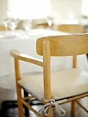 A Chair at a Set Table
