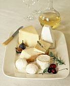 Cheese Still Life on Ironstone Plate with White Wine
