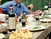 Outdoor Table with People and Wine
