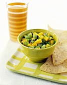 Mango and kiwi fruit salsa with tortilla chips