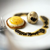 Quail's egg on mini-pancake with pepper sauce
