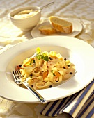 Ribbon pasta with vegetable and cream sauce