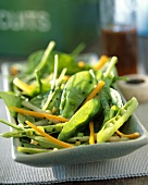 Spinach salad with pea pods and carrots