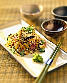 Asian rice salad with vegetables, black sesame and wasabi