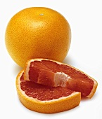 A Whole Red Grapefruit with Slices