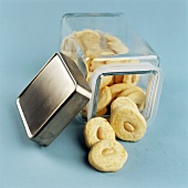 Almond Shortbread Cookies Spilling From Glass Canister