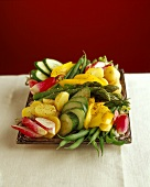 Vegetable platter with potatoes, asparagus, cucumber & radishes