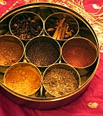 Various Indian spices in thali bowls (katoris)