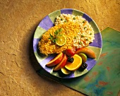 Fried Fish with Rice Pilaf and Sliced Fruit