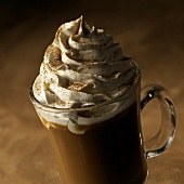 Capuccino in a Glass mug with Whipped Cream